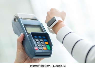 Woman pay by smart watch with NFC technolgoy