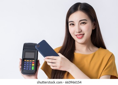 Woman pay with cellphone and payment terminal