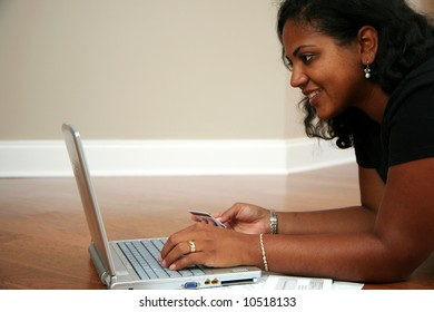 Woman paying bills on the computer