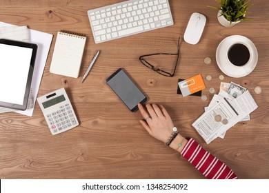 woman paying bills at online banking system