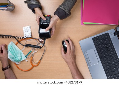Woman paying the doctor with credit card flat lay