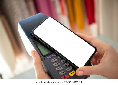 Woman payment purchase for phone with isolated screen and pay pass online terminal in the store