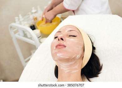 woman with peeling mask