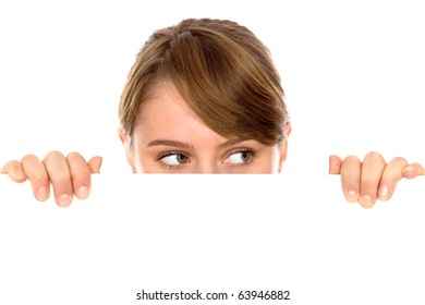 Woman peeping over a blank billboard