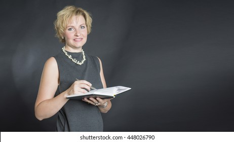 Woman with pen and notepad