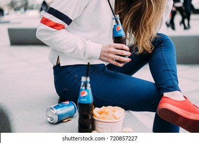 Woman with pepsi and chips