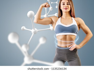 Woman with perfect athletic body near molecule chain. Slimming concept. Improvement of metabolism concept.