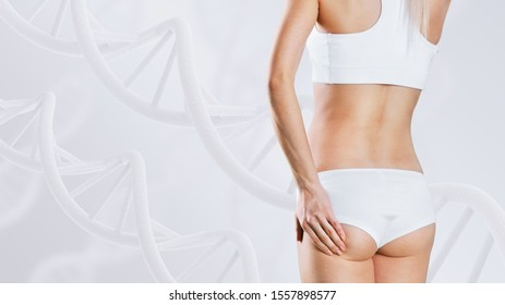 Woman with perfect body near DNA stems. Slimming concept. Improvement of metabolism concept.