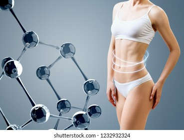 Woman with perfect body near glass molecule chain. Slimming concept. Improvement of metabolism concept.
