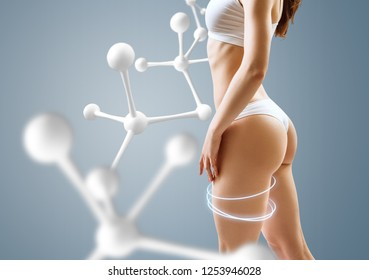 Woman with perfect body near molecule chain. Slimming concept. Metabolism improvemen concept.