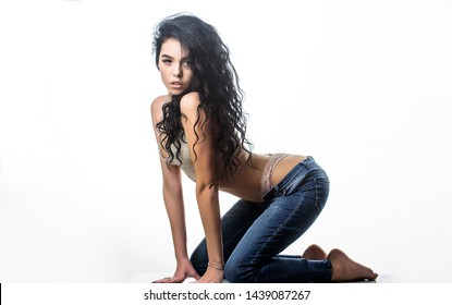 woman with perfect body relax. sensual girl with curly hair. Flexible body. erotic games. Isolated on white. fashion beauty. Diet and fitness.. sexy woman in jeans and bra. Hip and stylish.