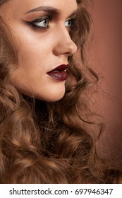 Woman with perfect make up and hairstyle in studio photo. Beauty and fashion. Hairstyle and make up