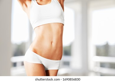 Woman with perfect slim and sport body shape