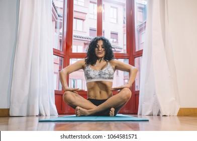 Woman performing abdominal hypopressive exercises