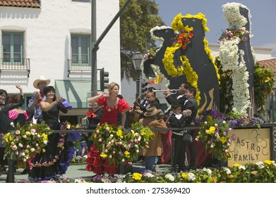 Woman performing Flamenco dancing on parade float during opening day parade down State Street, Santa Barbara, CA, Old Spanish Days Fiesta, August 3-7, 2005