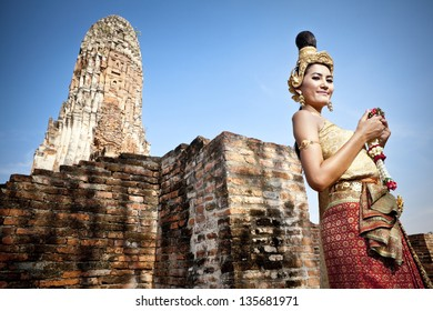 woman performing typical thai dance silhouetted with thai style temple background, identity traditional Thai culture