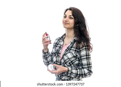 Woman with perfume bottle isolated on white