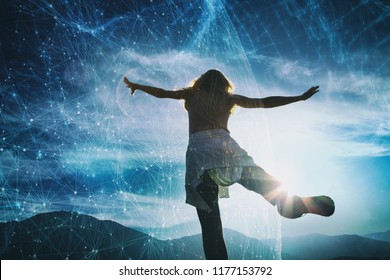 Woman person jumps on top of the hill with artistic digital cyberspace network sky background.