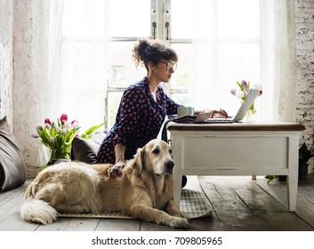 Woman Petting Golden Retriever Dog