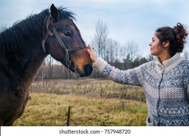 Woman petting a horse