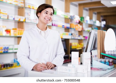 Woman pharmacist ready to assist in choosing at counter in pharmacy