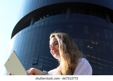 woman with the phone in the background of an office