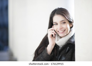woman at phone in the city