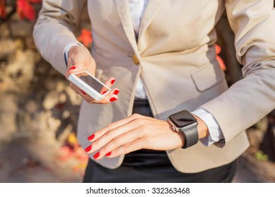 Woman with phone and digital watch