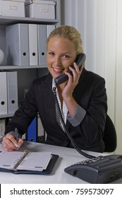woman with phone in the office