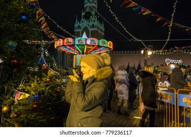 Woman photographer makes pictures  on christmas holidays