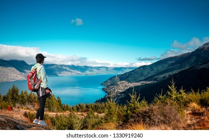 Woman photographer stand on Queenstown hill