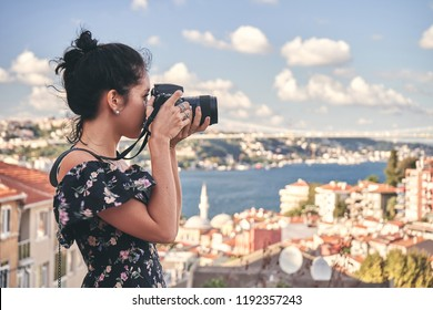 Woman photographer, taking pictures of landscape in old district in Istanbul