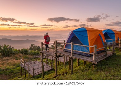 Woman photographer traveling and looking to beautiful view of the mountains range on Doi Sango (or Sa-Ngo) mountain in Chiang Saen district of Chiang Rai province of Thailand.