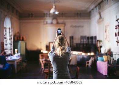 woman photographs the interior phone