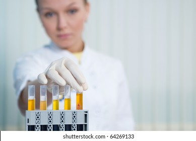The woman physician behind work in laboratory