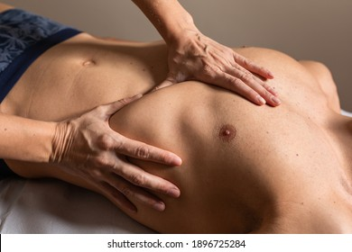 Woman physiotherapist does session to man. visceral ostropathy