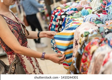 woman pick a roll of cloth at the fabric mall, Yongle market, Taipei, Taiwan, Asia