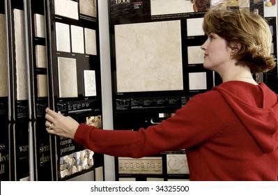 woman picking floor sample