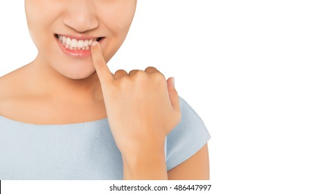Woman picking food stuck in teeth with finger, Concept with Healthcare And Medicine.