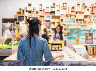 Woman picking product inside shop