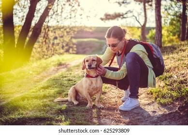 Woman picking a tick on dog fur
