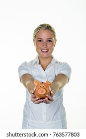 woman with piggy bank saves money