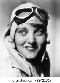 Woman with a pilots hat and goggles