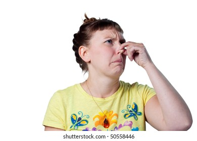 Woman pinches her nose, bad smells in the air
