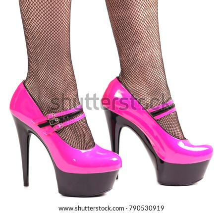 aeda6f849907 Woman in pink and black shiny patent leather platform stiletto high heels  isolated on white background