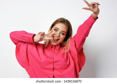 woman in pink clothes smiling dancing