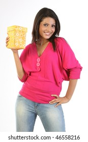 Woman in pink dress holding gift box