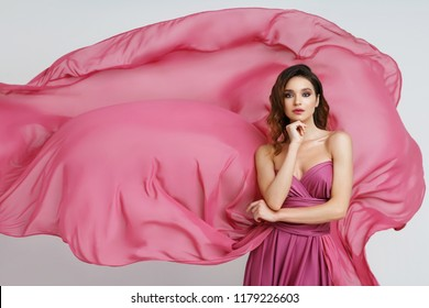 Woman In Pink Gown Flowing Fabric, Fashion Makeup