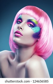 woman with pink hair and colourful make-up
