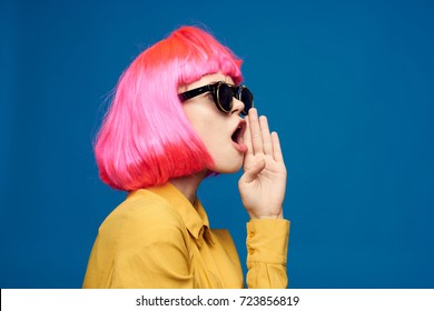 woman with pink hair with pink hair in profile screams on with a white background, beauty, style
